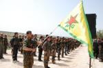 Nástup členov kurdských Jednotiek ľudovej obrany. Zdroj: www.haber.sol.org.tr